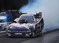 Jun 19, 2015; Bristol, TN, USA; NHRA funny car driver Jack Beckman during qualifying for the Thunder Valley Nationals at Bristol Dragway. Mandatory Credit: Mark J. Rebilas-
