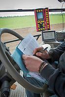 Drill operator filling in field paperwork