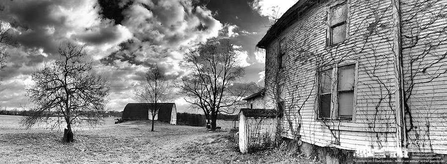 Barn and old farm house at the Braun Farm in Westerville OH in this black and white iPhone panorama.