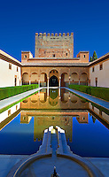 Arabesque Moorish architecture and pond of the  Court of the Myrtles  of the Palacios Nazaries,  Alhambra. Granada, Andalusia, Spain.