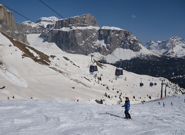 Woman skiing Col Rodella, above Canazei, Dolomites, Italy.