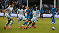 KANSAS CITY, KS - MAY 29: Gianluca Busio #10 of Sporting KC drives the ball down midfield during a game between Houston Dynamo and Sporting Kansas City at Children's Mercy Park on May 29, 2021 in Kansas City, Kansas.