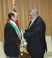 "Ismail Haniyeh, the Hamas leader in Gaza and prime minister in the government dismissed by President Mahmoud Abbas, gives a Palestinian flag to Alan Johnston (L), a BBC journalist, after he was released in Gaza July 4, 2007. Johnston, held hostage in the Gaza Strip since March, was handed over by his Islamist captors to ruling Hamas officials on Wednesday, Palestinian sources close to negotiations for his release said.""photo by Fady Adwan"""