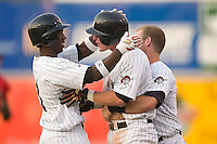 Hickory's Brad Corley (26) is congratulated teammate Andrew McCutchen after his single in the bottom of the 7th gave the Crawdads a 4-3 win over Kannapolis in game 1 of a double-header at L.P. Frans Stadium in Hickory, NC, Thursday, June 29, 2006.