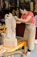 Wenzhou, Zhejiang, China.  Boxwood Carver Carving Figure of Military Leader Guan Yu, Arts and Crafts Research  Institute.