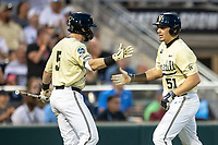 Vanderbilt Commodores outfielder JJ Bleday (51) celebrates with teammate Ethan Paul (5) during Game 12 of the NCAA College World Series against the Louisville Cardinals on June 21, 2019 at TD Ameritrade Park in Omaha, Nebraska. Vanderbilt defeated Louisville 3-2. (Andrew Woolley/Four Seam Images)