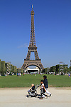 Interracial family with baby stroller, Paris, France,