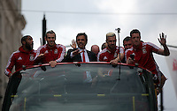 "Pictured L-R: Ashley Williams, Gareth Bale, manager Chris Coleman, Aaron Ramsey and Wayne Hennessey on top of the bus as it travels through St Mary's Street, Cardiff Friday 08 July 2016<br /> Re: Thousands of fans are expected to line the streets to welcome back the Wales national team. An open top bus will parade through Cardiff, from Cardiff Castle to Cardiff City Stadium where the Manic Street Preachers will play to 33,000 people.<br /> The parade comes after Wales lost 2-0 to Portugal in the semi-final on Wednesday, with their historic run hailed as a performance which has ""changed Welsh football forever""."