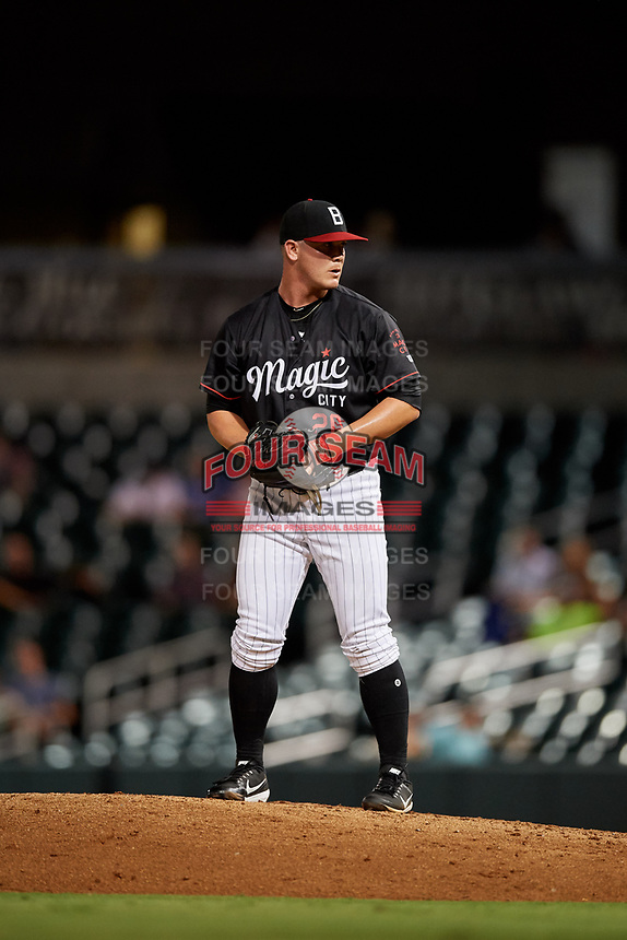 Birmingham Barons relief pitcher Matt Foster (20) gets ready to deliver a pitch during a game against the Tennessee Smokies on August 16, 2018 at Regions FIeld in Birmingham, Alabama.  Tennessee defeated Birmingham 11-1.  (Mike Janes/Four Seam Images)