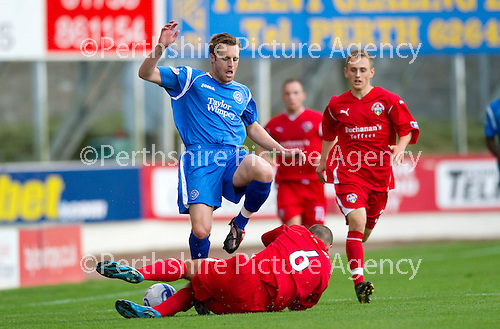 St Johnstone v Morton..24.08.10  CIS Cup Round 2.Michael Tidser slides in on Alan Maybury.Picture by Graeme Hart..Copyright Perthshire Picture Agency.Tel: 01738 623350  Mobile: 07990 594431