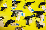 Americans change their weapons by money during gun buyback program in New Jersey