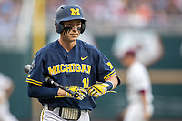 Michigan Wolverines third baseman Blake Nelson (10) walks back to dugout during Game 6 of the NCAA College World Series against the Florida State Seminoles on June 17, 2019 at TD Ameritrade Park in Omaha, Nebraska. Michigan defeated Florida State 2-0. (Andrew Woolley/Four Seam Images)
