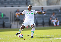 LOS ANGELES, CA - APRIL 17: Jhohan Romaña #3 of Austin FC passes off the ball during a game between Austin FC and Los Angeles FC at Banc of California Stadium on April 17, 2021 in Los Angeles, California.