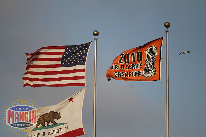 SAN FRANCISCO - JULY 9:  The 2010 World Series Champions banner belonging to the San Francisco Giants flies on a flag pole in the outfield during the game against the New York Mets at AT&T Park on Sunday, July 9, 2011 in San Francisco, California. Photo by Brad Mangin