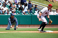 Jacksonville Jumbo Shrimp manager Randy Ready (5) gestures to Jeremias Pineda (not pictured) to tell him to slide as Trey Michalczewski (27) waits to receive a throw during a game against the Birmingham Barons on April 24, 2017 at Regions Field in Birmingham, Alabama.  Jacksonville defeated Birmingham 4-1.  (Mike Janes/Four Seam Images)
