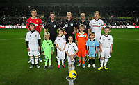 Pictured: Children macots with referees and team captains before kick-off. Saturday 19 November 2011<br /> Re: Premier League football Swansea City FC v Manchester United at the Liberty Stadium, south Wales.