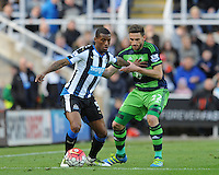 Georginio Wijnaldum of Newcastle United fends off Angel Rangel of Swansea City during the Barclays Premier League match between Newcastle United and Swansea City played at St. James' Park, Newcastle upon Tyne, on the 16th April 2016