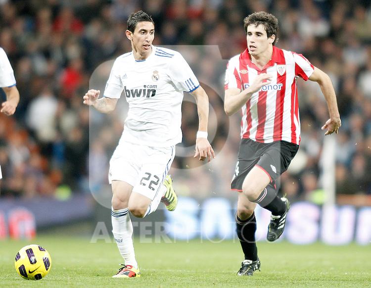 Real Madrid's Angel Di Maria against Athletic de Bilbao's Javier Martinez during La Liga match. November 20, 2010. (ALTERPHOTOS/Alvaro Hernandez).