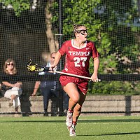 NEWTON, MA - MAY 14: Bridget Whitaker #27 of Temple University brings the ball forward during NCAA Division I Women's Lacrosse Tournament first round game between University of Massachusetts and Temple University at Newton Campus Lacrosse Field on May 14, 2021 in Newton, Massachusetts.