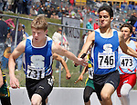RAPID CITY, SD - MAY 30: Jake Aanderud #731 of St. Thomas More gets a handoff from teammate Giles McGillick #746 during the 2015 SDHSAA State Track & Field Meet Saturday at O'Harra Stadium in Rapid City, S.D. (Photo by Dick Carlson/Inertia)