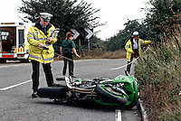 A road traffic accident involving a motorbike and a van. The driver of the van went too fast around the bend and clipped the motorbike coming the other way. The traffic police officers can be seen taking measurements for accident investigation reasons and this evidence may well be used in court. ..© SHOUT. THIS PICTURE MUST ONLY BE USED TO ILLUSTRATE THE EMERGENCY SERVICES IN A POSITIVE MANNER. CONTACT JOHN CALLAN. Exact date unknown.john@shoutpictures.com.www.shoutpictures.com...