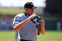 Home plate umpire Travis Carlson during a game between the Columbus Clippers and Buffalo Bisons at Coca-Cola Field on May 31, 2012 in Buffalo, New York.  Columbus defeated Buffalo 3-0.  (Mike Janes/Four Seam Images)