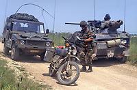 - a German paratroopers light tank Wiesel with a Belgian motorcyclist during NATO AMF (Allied Mobile Force) exercises in Southern Italy (May 1993)<br /> <br /> - un carro armato leggero Wiesel dei paracadutisti  tedeschi e un motociclista dell'esercito belga durante esercitazioni NATO AMF (Allied Mobile Forrce) in Italia meridionale (Maggio 1993)