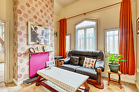 BNPS.co.uk (01202 558833)<br /> Pic: PropertyPublicity/BNPS<br /> <br /> Pictured: The living room<br /> <br /> Loco-cation, loco-cation, loco-cation..<br /> <br /> This quirky property that is up for sale is all about its loco-cation - as it sits on a railway crossing right next to the train tracks.<br /> <br /> The Grade II listed cottage was built in 1850 to house the gatekeeper whose job it was to close the gates at the road crossing whenever a train was due.<br /> <br /> The gates, in the village of Stone, Staffs, were automated many years ago.