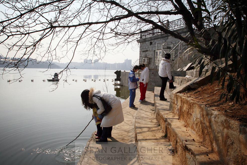 CHINA. Jiangxi Province.  Jiujiang. People in a park. Jiujiang is a city of 4.6 million people, located on the southern shore of the Yangtze River.  2008