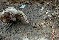 The skeleton of a Bosnian Muslim man executed during the Bosnian war is exhumed from a mass grave in Republica Srpska. It is suspected that the men were murdered during the Srebrenica massacre in 1995. Most of the bodies at the site had their hands tied behind their backs with wire.