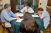 MR / Schenectady, NY.10th grade students (aged 16; girl: Colombian American) are tutored for NYS Math B Regents test (an exam required of all high school students in New York State for graduation) by private tutor. Tutor is math enthusiast; stockbroker by day but sees dozens of students in his home weekly after work..MR:  Sen3, She5, Del13.©Ellen B. Senisi