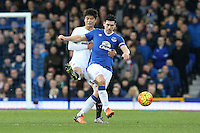 Ki Sung-Yueng competes with Gareth Barry during the Barclays Premier League match between Everton and Swansea City played at Goodison Park, Liverpool