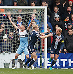 Andrew Davies scores for Ross County and celebrates