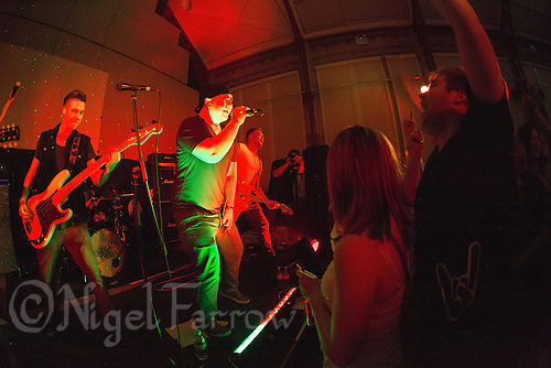 10 Jan 2015 - STOWMARKET, GBR - Sam Robson (centre) on vocals and Josh Barnard (left) on bass guitar as Renegade Twelve perform at the John Peel Centre for Creative Arts in Stowmarket, Suffolk, Great Britain (PHOTO COPYRIGHT © 2015 NIGEL FARROW, ALL RIGHTS RESERVED)