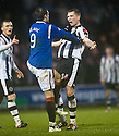 RANGERS' NIKICA JELAVIC AND ST MIRREN'S MARC MCAUSLAND CLASH DURING THE SECOND HALF