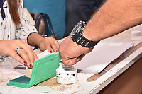 A Tunisian voter dips his finger in ink after casting his ballot for presidential election at a polling station in Ben Arous near the capital Tunis, on September 15, 2019. - Rarely has the outcome of an election been so uncertain in Tunisia, the cradle and partial success story of the Arab Spring, as some seven million voters head to the polls today to choose from a crowded field.<br /> <br /> PHOTO : Agence Quebec Presse -  JDIDI_WASSIM