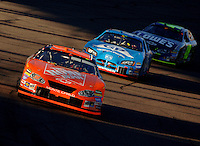 Nov 13, 2005; Phoenix, Ariz, USA;  Nascar Nextel Cup driver Tony Stewart driver of the #20 Home Depot Chevy leads a pack of cars during the Checker Auto Parts 500 at Phoenix International Raceway. Mandatory Credit: Photo By Mark J. Rebilas