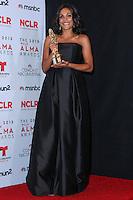 PASADENA, CA - SEPTEMBER 27: Actress Rosario Dawson poses in the press room during the 2013 NCLR ALMA Awards held at Pasadena Civic Auditorium on September 27, 2013 in Pasadena, California. (Photo by Xavier Collin/Celebrity Monitor)