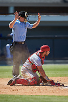 Greeneville Reds catcher Hunter Oliver (28) blocks a pitch in the dirt as home plate umpire Kyle Stutz calls time during the game against the Burlington Royals at Burlington Athletic Stadium on July 8, 2018 in Burlington, North Carolina. The Royals defeated the Reds 4-2.  (Brian Westerholt/Four Seam Images)