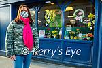 Suzanne Dunne Raggett standing outside her shop window display in Kevin Barrys on Rock Street on Thursday.