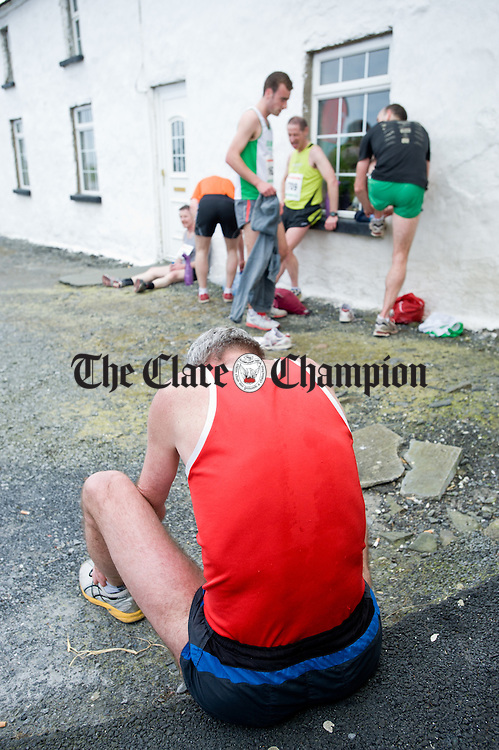 Athletes recover their breath following the Kilmurry Ibrickane-North Clare Michael Egan memorial 4 mile Run/Walk in Quilty. Photograph by John Kelly.