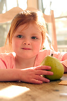 Young girl with a pear.