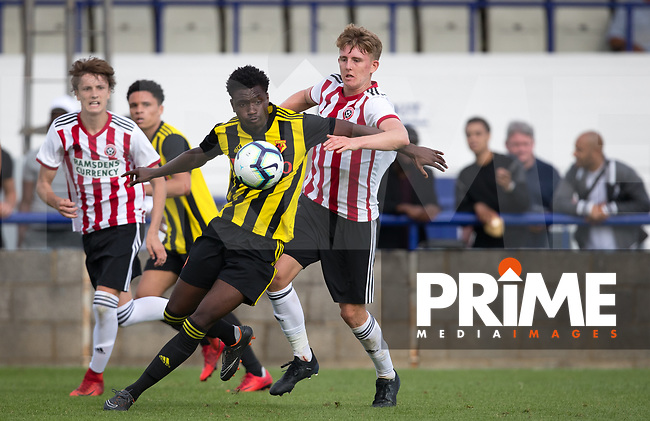 Sam Sesay of Watford holds off Reece York of Sheffield United during the Professonal Development League match between Watford U23 and Sheffield United U23 at The Maurice Rebak Stadium, Summers Lane, England on 17 August 2018. Photo by Andy Rowland.