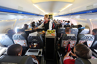 Wednesday 07 August 2013<br /> Pictured: An air stewardess serving food to fooballers en route to Malmo.<br /> Re: Swansea City FC travelling to Sweden for their Europa League 3rd Qualifying Round, Second Leg game against Malmo.