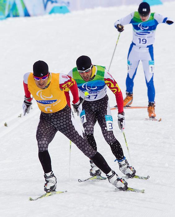 Brian McKeever and Robin McKeever, Vancouver 2010 - Para Nordic Skiing // Ski paranordique.<br /> Brian McKeever and guide Robin McKeever compete in Para Nordic Skiing // Brian McKeever et le guide Robin McKeever concourent en ski paranordique. 15/03/2010.