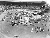 """Rose Festival parade, Friday, June 8, 1951 """"Panorama of blossom-decked floats, assembled in Multnomah stadium for the 43d annual grand floral parade of the Portland Rose Festival, contains several prize winners, In front, left to right, are Shell Oil float, first prize in its section; Portland General Electric, public utilities winner; engine No. 3, first from Fire Bureau. At top, center, is Hollywood Boosters' replica of the Skidmore Fountain, sweepstakes winner in the commercial division, and immediately below  it is the noncommercial sweepstakes winner of the Vancouver Fire department. Pasadena entry, another winner, is at right."""""""