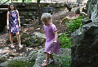 Emily Kleczka, 13, of Kans. (from left) and Isabelle Keller, 4, of Lincoln explore rocks, Sunday, September 13, 2020 along the Art Trail in Bentonville. Kleczka is visiting from Kansas and spent some time inside of Crystal Bridges and the nearby Art Trail. Check out nwaonline.com/200914Daily/ for today's photo gallery. <br /> (NWA Democrat-Gazette/Charlie Kaijo)