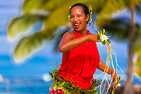 Polynesian woman with Tiare flowers performing traditional dance with blurred palm tree and lagoon background in Tahiti Papeete, French Polynesia