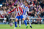 Esteban Felix Granero Molina (R) of Real Sociedad competes for the ball with Fernando Torres (L) of Atletico de Madrid during their La Liga match between Atletico de Madrid vs Real Sociedad at the Vicente Calderon Stadium on 04 April 2017 in Madrid, Spain. Photo by Diego Gonzalez Souto / Power Sport Images