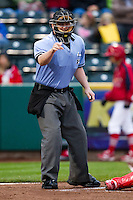Home Plate Umpire Gabriel Morales calls a strike during a game between the Springfield Cardinals and Northwest Arkansas Naturals on May 13, 2011 at Hammons Field in Springfield, Missouri.  Photo By David Welker/Four Seam Images